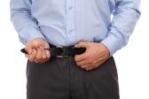 bigstock-Businessman-tightening-his-bel-51568765