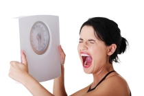 bigstock-Frustrated-woman-with-scale-i-39025033
